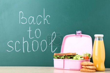 Photo for School lunch box with sandwich and inscription on chalkboard - Royalty Free Image