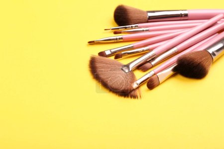 Photo for Set of makeup brushes on yellow background - Royalty Free Image