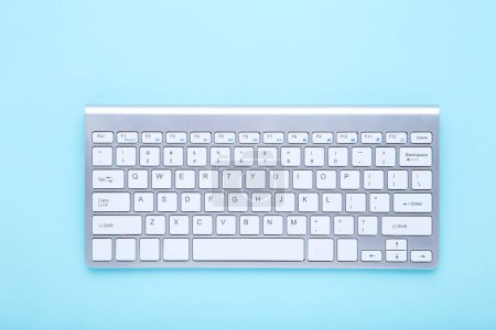 Computer keyboard on blue background