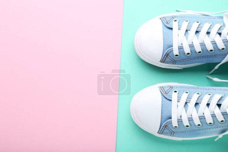 Photo for Pair of blue sneakers on colorful background - Royalty Free Image