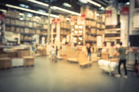 Photo for Vintage tone blurred customers shopping in large furniture warehouse with row of aisles and bins from floor to ceiling. Industrial storehouse interior. Inventory, wholesale, logistic, export - Royalty Free Image