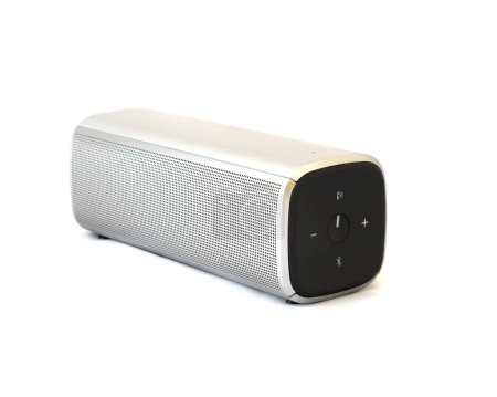 Photo for Grey bluetooth speaker with rechargeable batteries isolated on white background. Wireless speaker for digital music listening. - Royalty Free Image