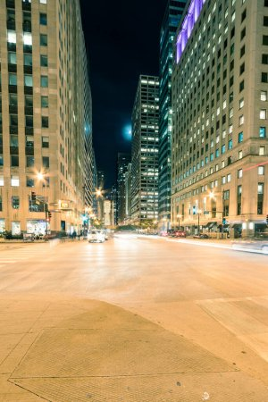 Photo for Busy traffic at Wacker Dr street in downtown Chicago at evening time. Beautiful modern cityscape view of skyline, skyscraper buildings and light trails at blue hour, dusk. - Royalty Free Image
