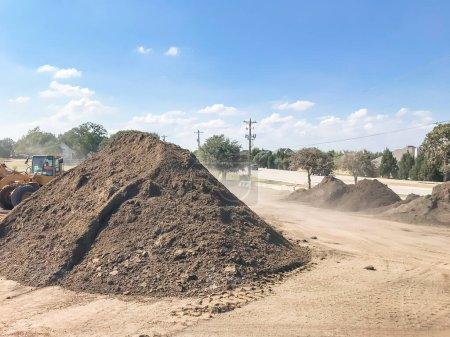 Giant pile of compost, mulch, sand, gravel, soil, ...