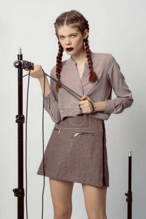 Beautiful brunette model posing in studio on white background