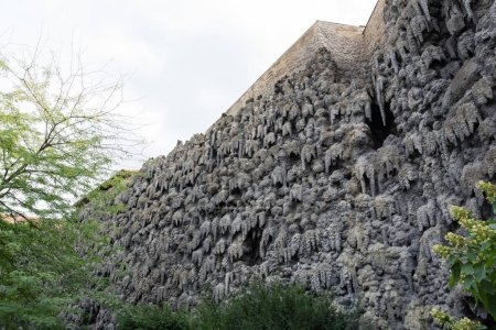 The artificial stalactite wall made of lime stucco in early Baroque Wallenstein Garden, built with the Wallenstein Palace, from 1623 to 1630, in Prague, Czech Republic