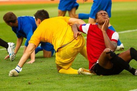 ZAPORIZHYA, UKRAINE - AUGUST 5, 2012:  soccer players in action at football mach, Club Metalurg