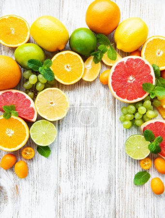 Citrus fresh fruits on a old wooden background...