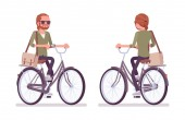 Young red-haired man riding a bicycle