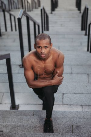 Photo for Portrait of topless Afro-American sportsman ready to training. - Royalty Free Image