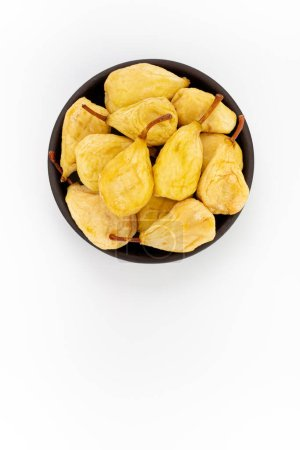 Photo for Dried Pears in round bowl on white background, top view - Royalty Free Image