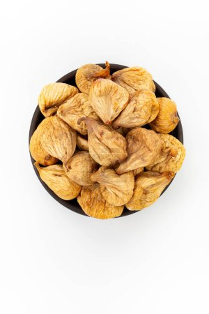Photo for Dried figs in round bowl on white background, top view - Royalty Free Image