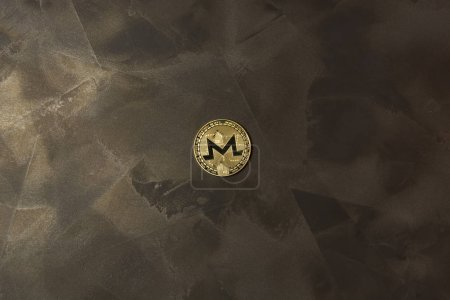 Photo for Golden monero lie on dark background maded from decorative plaster - Royalty Free Image
