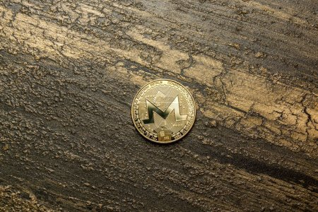 Photo for Golden monero on background maded from decorative plaster - Royalty Free Image