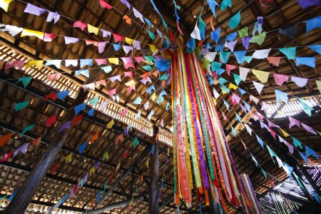 Details of decoration and colored flags suspended in decoration of June party