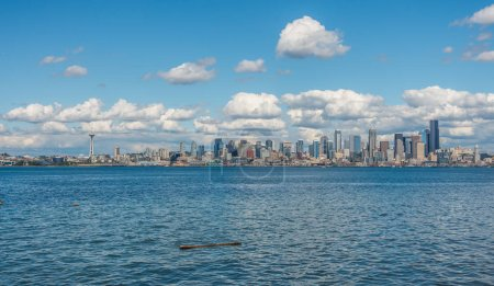 A view of the Seattle skyline with puffy clouds above.