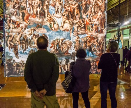 Tacoma, WA, USA - October 11, 2018        Art lovers appreciate the hangings at the Michaelangelo Sistine Chapel art exhiibt. Location is the Tacoma Armory.