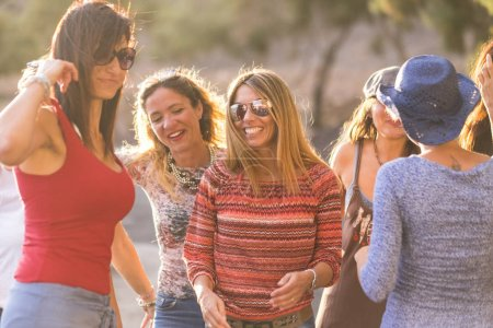 people group of beautiful young women outdoor in leisure with casual clothes and dress. summer time and sun day of summer. leisure outdoor activity in friendship concept