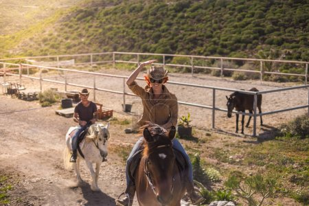 couple riding on brown and white horses, outdoor leisure activity at daytime