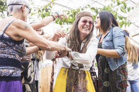 Photo for Group of crazy women in hippy style dress at party - Royalty Free Image
