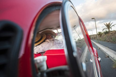 Love kiss captured from a car glass. two senior ma...