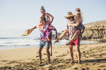 Photo for Cheerful group of people boys and girls have fun together at the beach during summer holiday vacation - Royalty Free Image