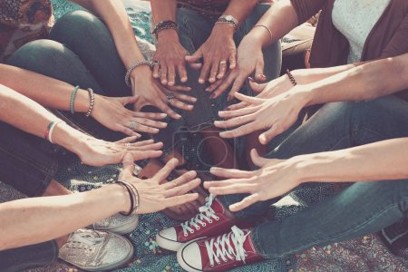 team and friendship concept with crowd of hands and feet all together touching and cooperate