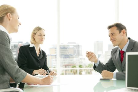 Photo for Corporate people having a business meeting in office - negotiation and talks - Royalty Free Image