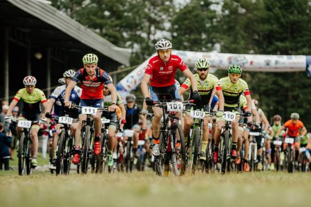 Photo for V.Ufaley, Russia - August 12, 2018: start large group of athletes cyclists mountain bikers during race XCM Big stone - Royalty Free Image