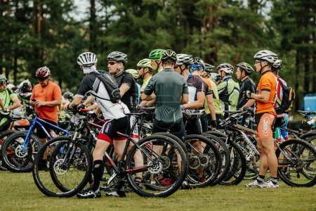 Photo for V.Ufaley, Russia - August 12, 2018: group athletes cyclists before start of race during race XCM Big stone - Royalty Free Image