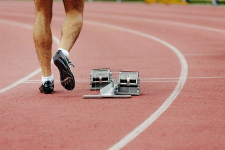 Photo for Feet men runner sprinter track and starting blocks - Royalty Free Image