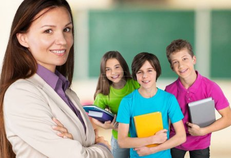 Female teacher with children at class on background
