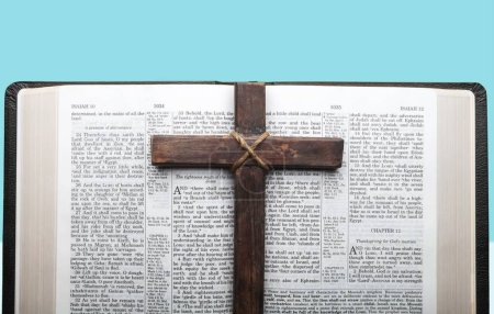 Holy wooden cross with bible on  background