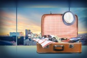 Retro suitcase with colorful clothes, travel concept