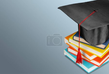 Photo for Graduation hat and stack of books - Royalty Free Image