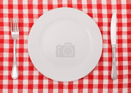 White Plate on napkin, fork and knife
