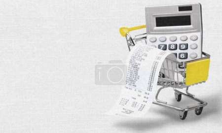 Photo for Cash check and calculator in shopping cart - Royalty Free Image