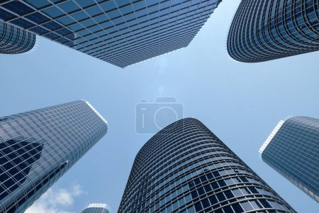Photo for 3D illustration Low angle view of skyscrapers. Skyscrapers at in day looking up perspective. Bottom view of skyscrapers in business district in daylight. Business concept of success. - Royalty Free Image