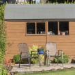 A Dutch style wooden garden shed with patio and tw...