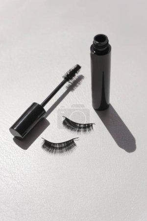 Photo for Black false lashes strips with mascara on white background - Royalty Free Image