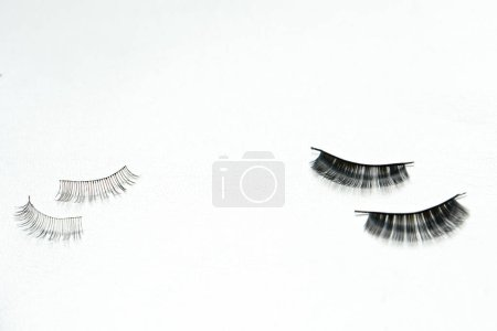 Photo for Two Black false lashes strip sets on white background - Royalty Free Image