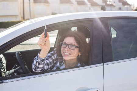 Attractive business woman with car keys