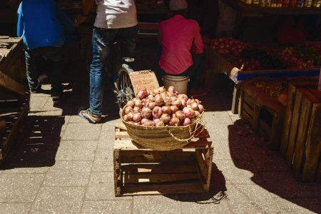 Wicker basket full of onions in the African market