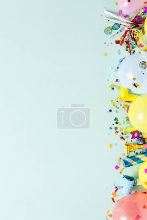 party decoration on pastel blue background