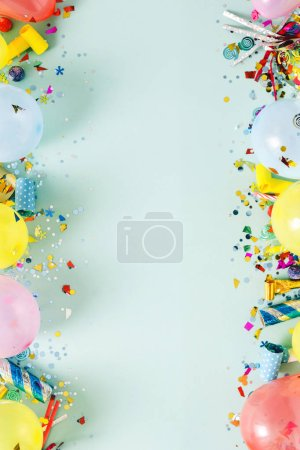 Flat lay decoration party concept on pastel blue background top view