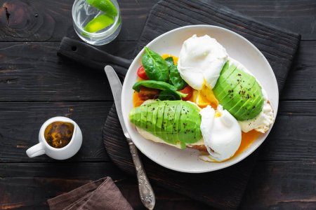 Healthy Breakfast Toast With Poached Egg, Avocado And Cheese And On White Background Top View Tasty Food