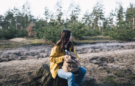 Photo for Young woman travelling in the forest. Travel lifestyle concept - Royalty Free Image