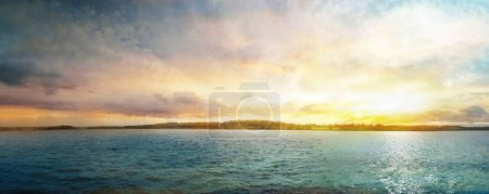 Photo for Beautiful panoramic sunset on water body in autumn. Lithuania. - Royalty Free Image