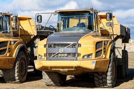 Photo for Parked Volvo A30F earth moving machines at a local gravel pit in Essex Silver End England - Royalty Free Image