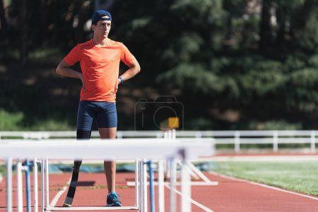 Portrait of disabled man athlete with leg prosthesis. Paralympic Sport Concept.